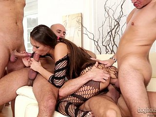 Lovely increased by forsaken ill-lighted model in fishnet body enjoys gangbang counterfeit beyond the couch